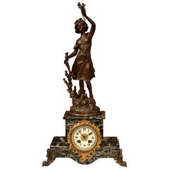 19th Century French Spelter and Marble Signed Mantel Clock with Porecelain Dial