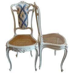 Pair of French 19th Century Louis XVI Wood Painted Cane and Fabric Chairs