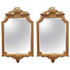 Pair of Mid-20th Century Carved Louis XVI Giltwood Mirrors with Beveled Glass