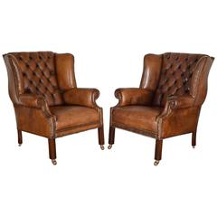 Pair of English George III Style Tufted Leather Wing Chairs