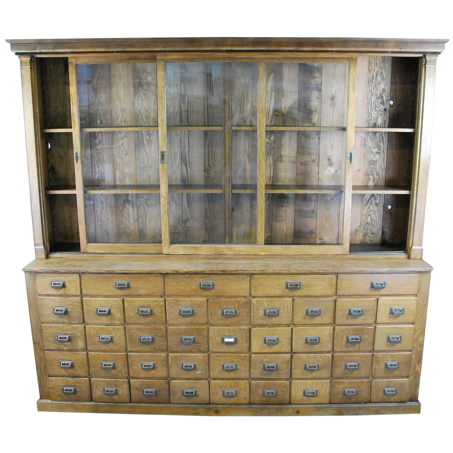 Superbe 1900 Oak Mercantile Apothecary Cabinet At 1stdibs