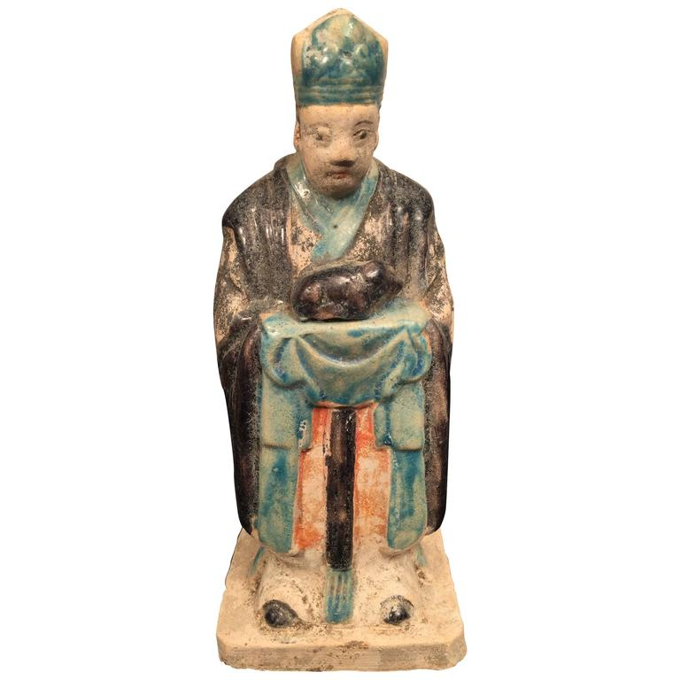 Important Ancient Chinese Zodiac figure holding a SHEEP Ming Dynasty, 1368-1644.  This interesting zodiac figure is one in a series of twelve tomb figures each brandishing a different animal from the zodiac. Look for other listings offering the