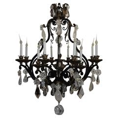 Large French Wrought Iron Gilt Bagues Rock Crystal Twelve Light Chandelier