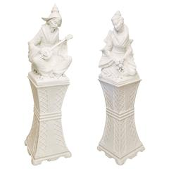 Pair of Large Blanc de Chine Musician and Maiden Figures on Pedestals
