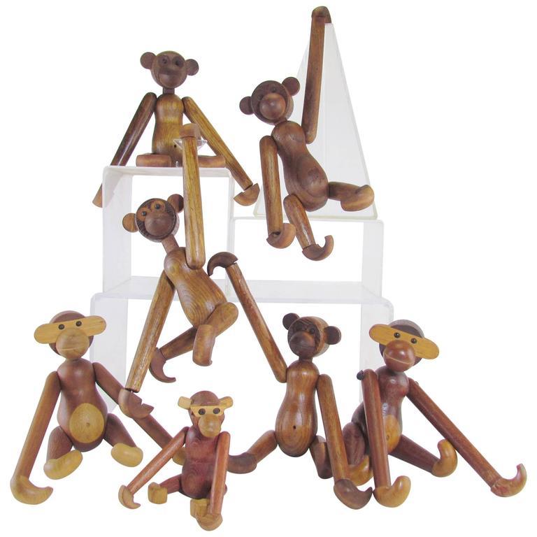 Mid-Century Modern Grouping of Teak Monkey Toys
