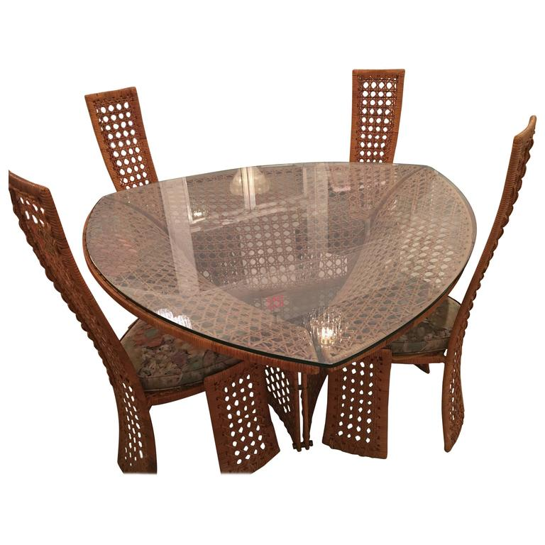 Danny ho fong dining table set and four side chairs rattan for Dinner table set for 4