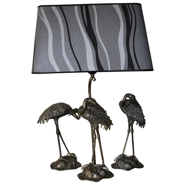 Maison Jansen table lamp and statues  crane
