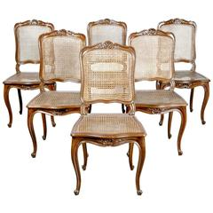 Set of Six French Louis XV Style Cane Dining Chairs in Walnut