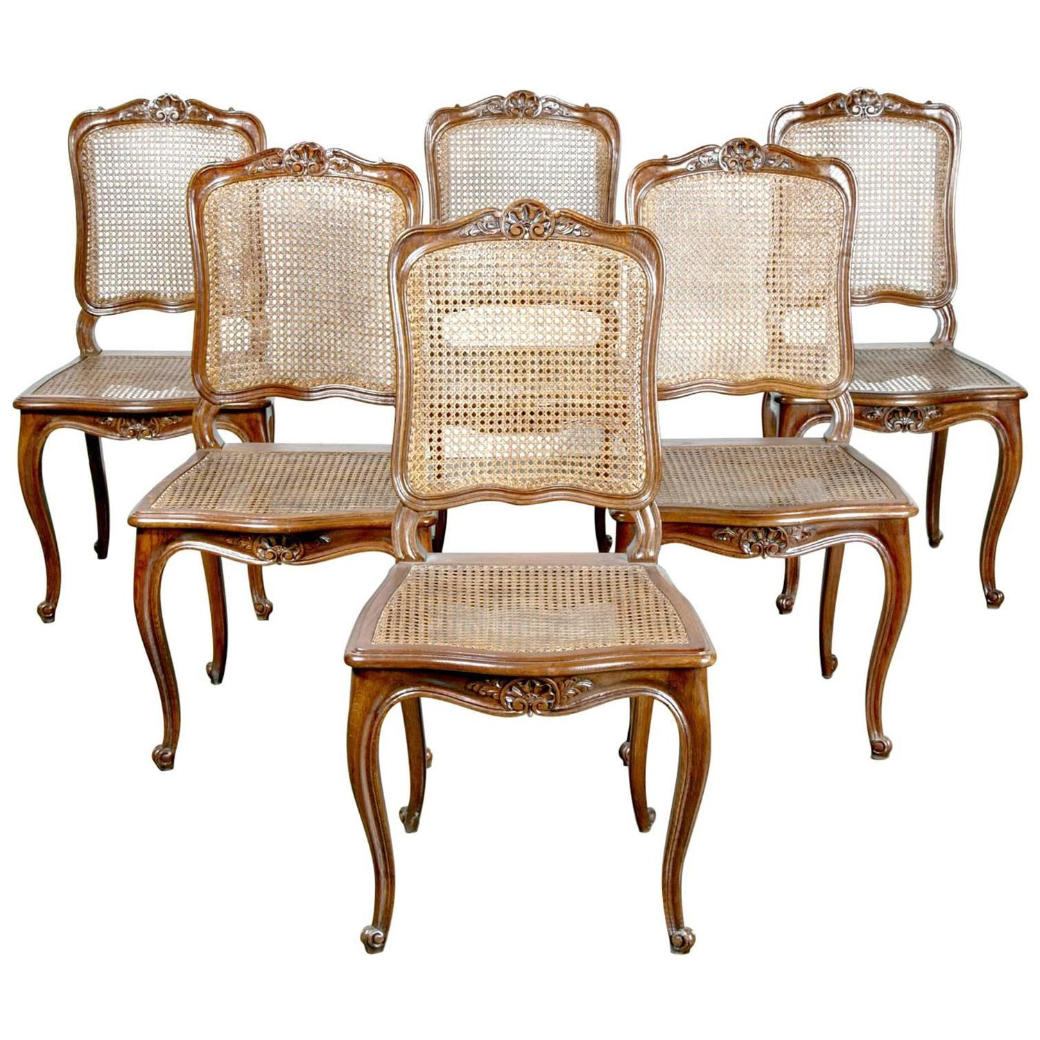 Set of Six French Louis XV Style Cane Dining Chairs in Walnut at