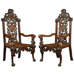 Pair of 19th Century Carved Oak Armorial Armchairs
