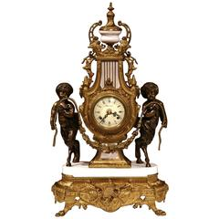 Early 20th Century Italian Carved Bronze and Marble Clock with Patinated Cherubs