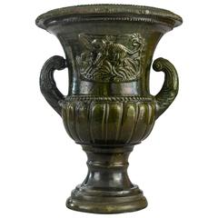 A French Green Glazed Faience Campana Urn with Elephant Relief