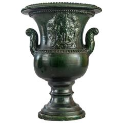 A French Green Glazed Faience Campana Urn with Classical Relief