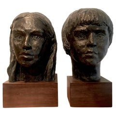 Pair of Plaster Boy and Girl Sculptures
