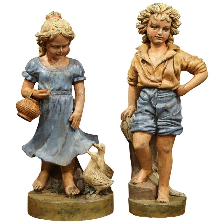 Pair of Mid-20th Century French Polychrome Boy and Girl with Ducks Iron Statues