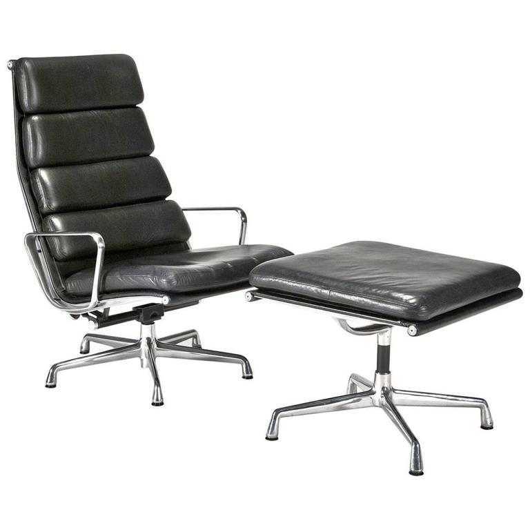 leather soft pad executive chair and ottoman by charles and ray eames