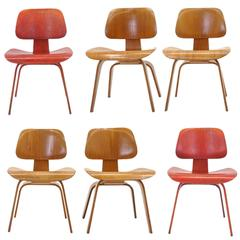 Set of Six Eames DCW's, Two Red Aniline Dyed Ash Plywood, Four Natural, Original