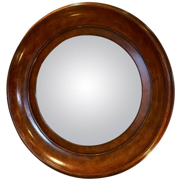 Handsome convex mirror in rich round burl wood frame at Round framed mirror