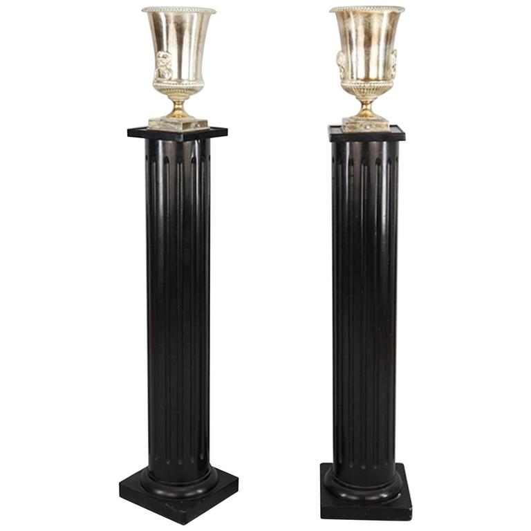 One Pair Of Hollywood Regency Ebonized Fluted Columns With Silver Plate Uplight. For Sale