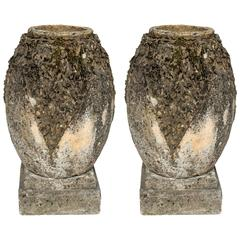 Pair of Striking Cement Normandy Garden Vases with Decorated Sides