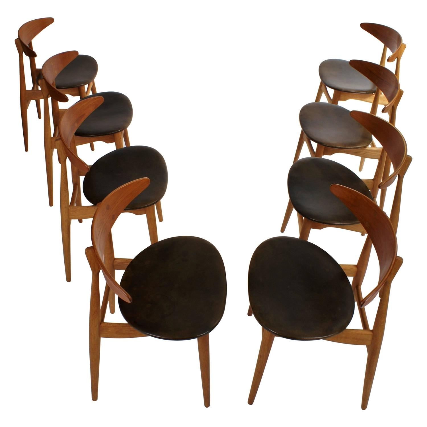 Hans Wegner Set of Eight Round Back Dining Chairs in Mahogany and