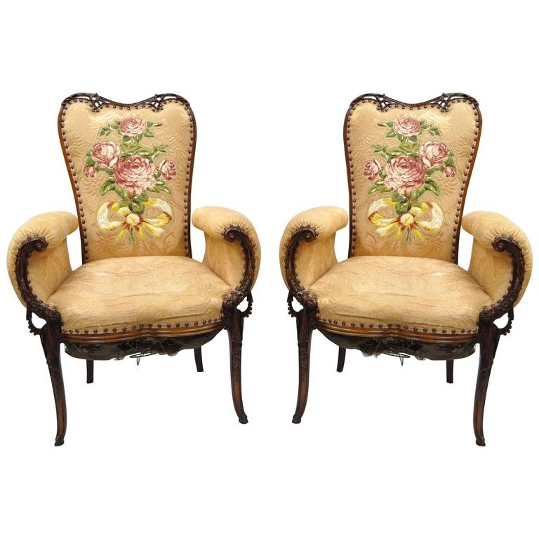 pair of carved mahogany hollywood regency fireside chairs after grosfeld house 1