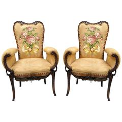 Pair of Carved Mahogany Hollywood Regency Fireside Chairs after Grosfeld House