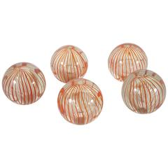 Collection of Handblown Clear and Air Twist Red Filament Paper Weights