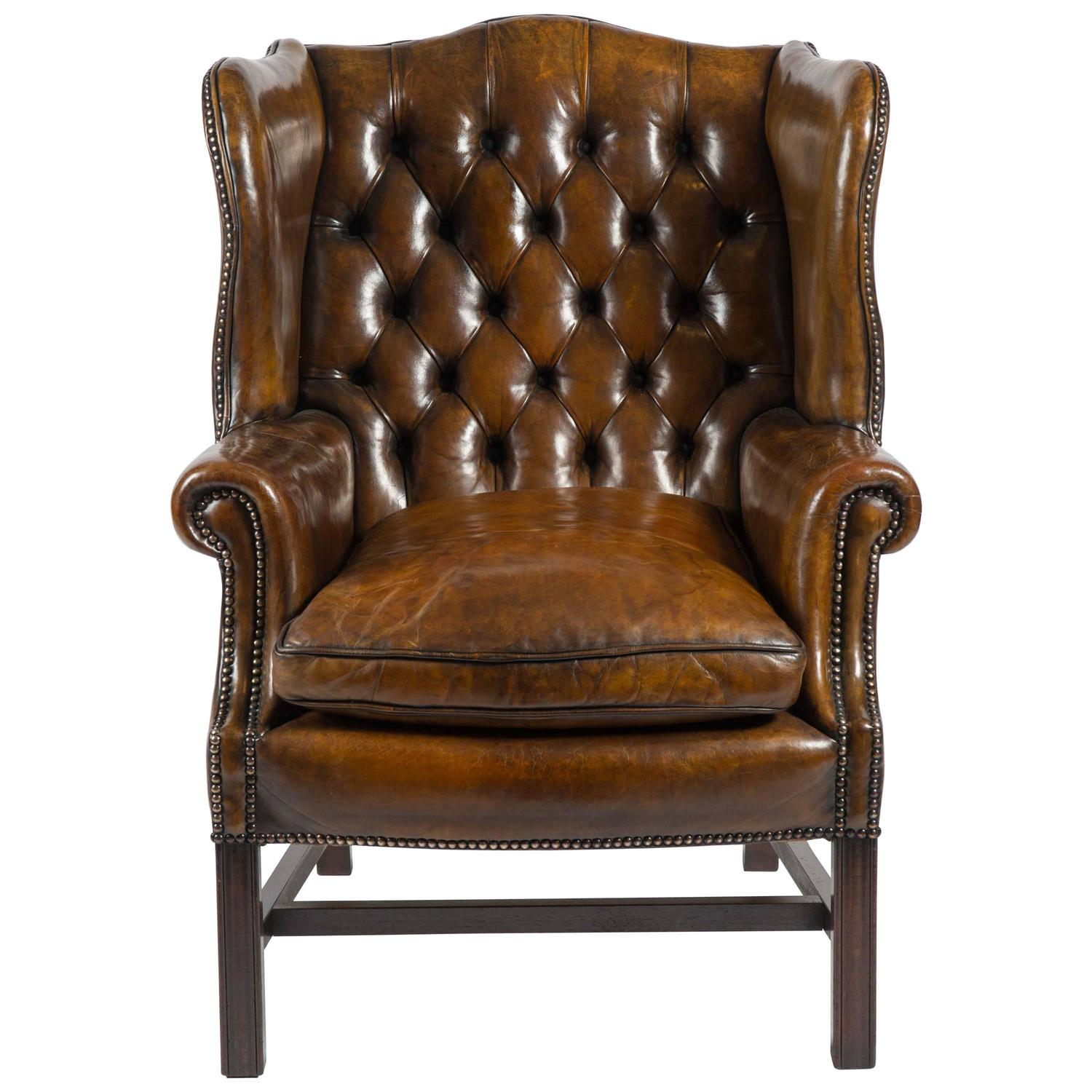 Early 20th Century Leather Buttoned Back Wing Chair at 1stdibs