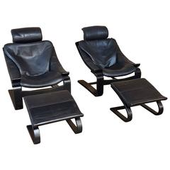 Pair of Nelo Swiss Leather Lounging Chairs with Ottomans