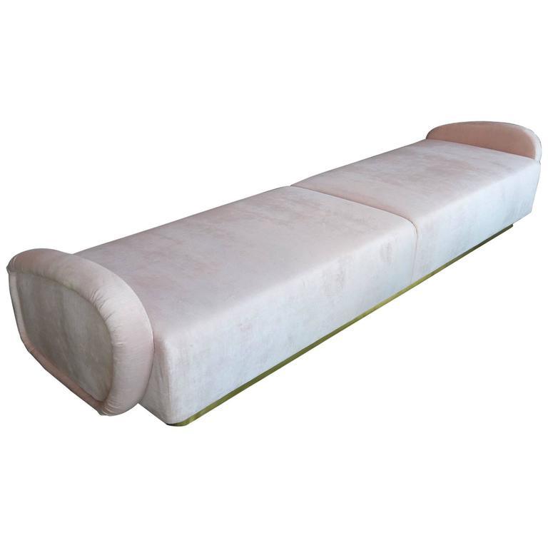 Custom 1960s Italian style sofa or bench with brass base, upholstered in light pink velvet.