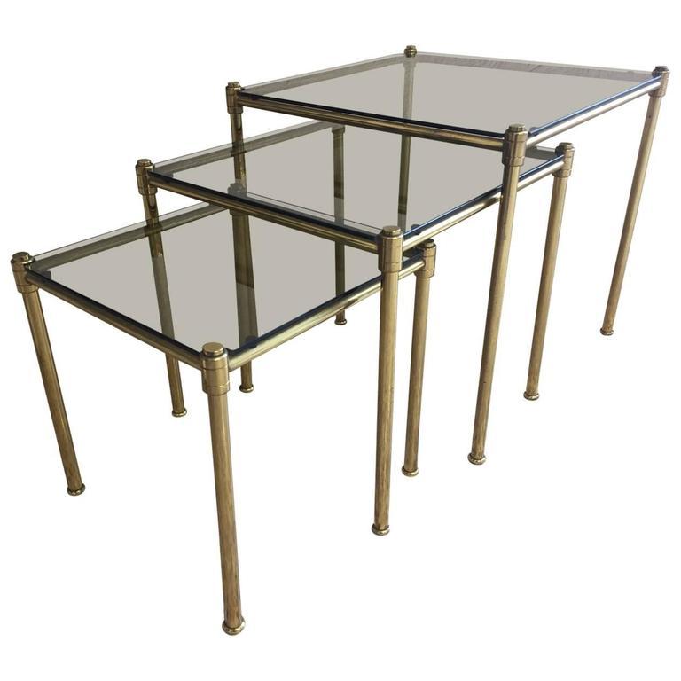 Set of Three Brass and Fumè Glass Nesting Tables, circa 1960