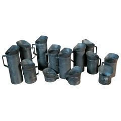 Set of 13 French Zinc Handmade Pitchers
