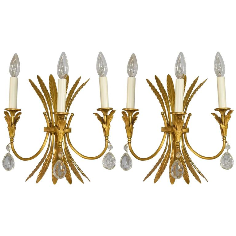 Pair of Italian Neoclassic Style Three-Arm Brass Wall Sconces