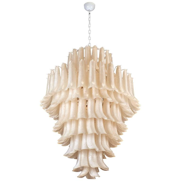 Stunning chandelier made of Murano glass pieces overlapping to create a feathered effect. The handblown glass was created using the 'Scavo' technique, leaving the pieces to have an etched or corroded finish on one side. This beautiful chandelier has