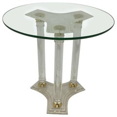 A French Mid-Century Modern Circular Lucite and Brass Side Table.