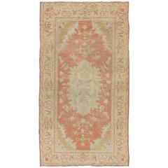 Antique Turkish Oushak Rug with Floral Motifs and Coral Background