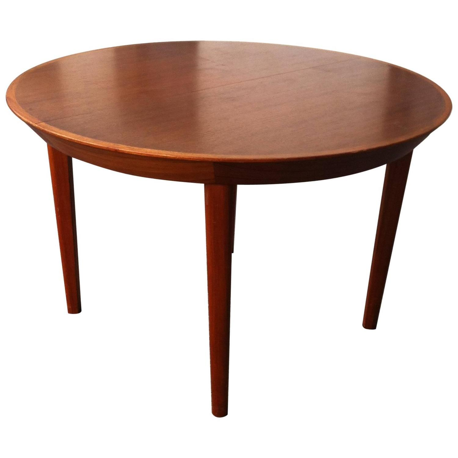exceptional round extentional danish 1960s dining table in teak by