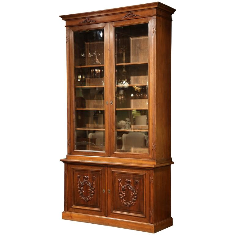 Tall Early 20th Century French Carved Walnut Bookcase With Beveled