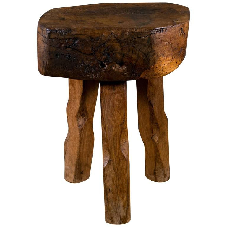 Elegant Primitive And Rustic Hand Carved Wooden Stool Or Side Table With Three Legs  For Sale