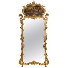 A Large Louis XV Rococo Carved Giltwood Trumeau Mirror