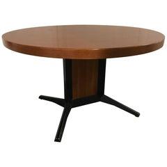Table by Daciano Da Costa