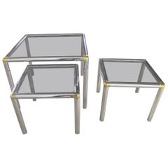 Tubular Chrome Brass and Smoke Glass Trio of Cocktail or End Table