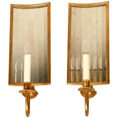 Contemporary One-Light Sconces with Curved Segmented Mirror Back