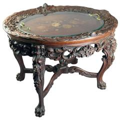 Antique Carved and Inlaid Figural Tea Table with Lion, Cherubs, Paw Feet