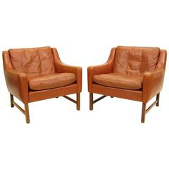 Two Cognac Leather and Rosewood Lounge Chairs by Fredrik Kayser