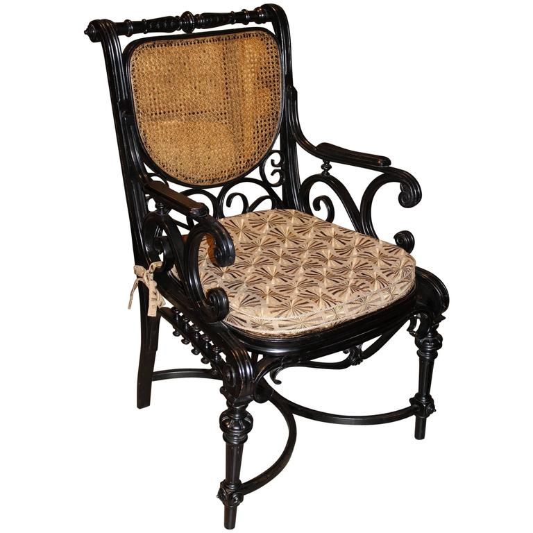 Anglo Raj Ebonized Bentwood Armchair with Caned Seat and Back