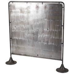 A Mid-Century Industrial Metal Screen