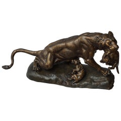 A Gilt Spelter Lioness with her Cubs, Signed Thomas Cartier