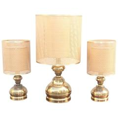 Triptych of Brass Lamps with Thatched Dome